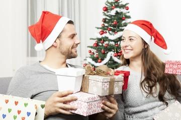 couple giving christmas presents