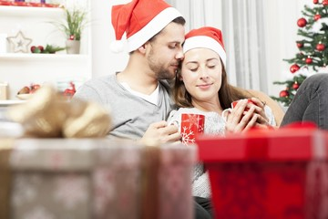 young christmas couple relaxing on sofa