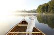 Dog Navigating From the Bow of a Canoe - 71656511