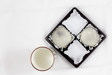 Half Pack of White Mochi and Empty Japanese Tea Cup
