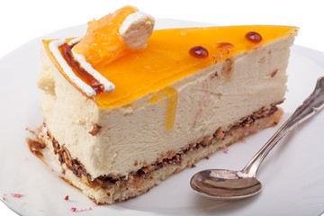 Piece of cake with orange on the plate