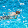 teen swims in the pool