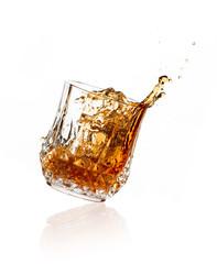 Splashing Whiskey on Glass over White Background