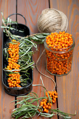 Sea buckthorn on a wooden table