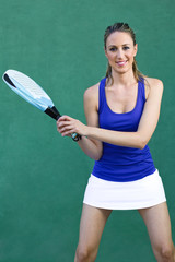 woman holding racket paddle. sportswoman.