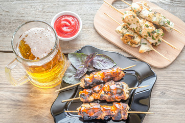 Grilled chicken skewers with herbs and spicy sauce