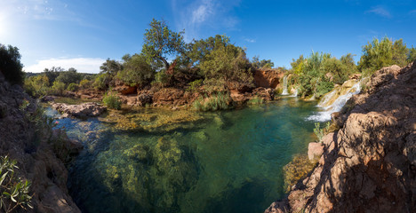 Panorama view of a small waterfalls near the city of Tavira in A