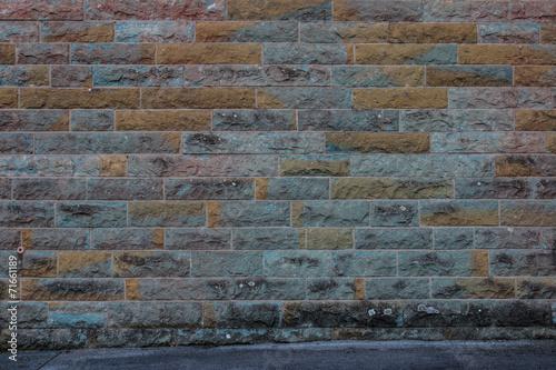 canvas print picture Hintergrund – gelb grüne Sandsteinmauer