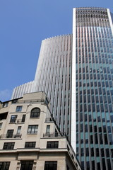 Modern skyscraper in London contrasted with vintage buildings