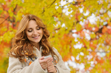 portrait of beautiful attractive stylish young woman typing sms
