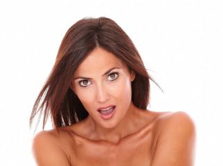 Surprised latin woman looking at camera
