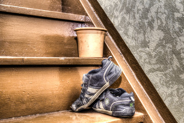 Old children's shoes on a stairway