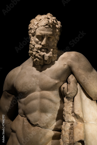 Papiers peints Statue A statue of powerful Hercules, closeup, isolated in black