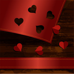 hearts cut from red paper on wood texture