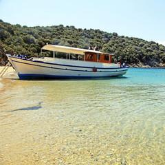 Small traditional ship on a sandy beach, Greece