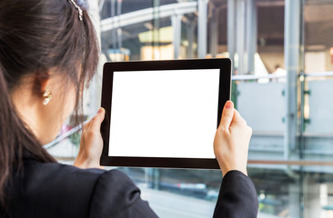 Businesswoman looking tablet. Space for your picture.