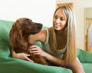 Adult girl with red Irish setter