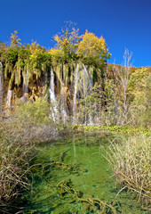 Green lake under Plitvice waterfall