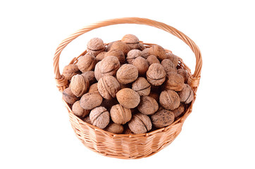 Pile of walnut in basket isolated on white