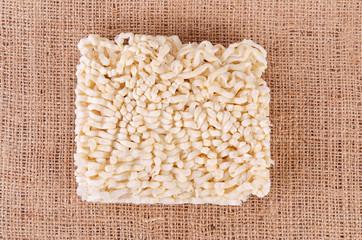 Closeup photo of pasta on sackcloth