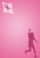 Woman with kite with pink ribbon