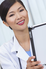Chinese Female Woman Hospital Doctor Using Tablet Computer
