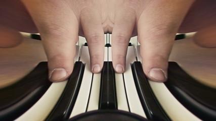 Bizarre fingers playing piano
