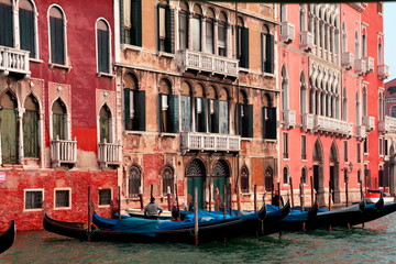 Venice Italy and gondolas waiting for passengers.