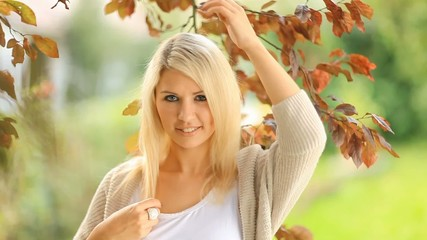Beautiful, blonde young woman in the garden