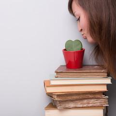 lovely girl loving her plant and her books