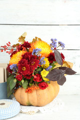 Beautiful autumn composition in pumpkin and box with old