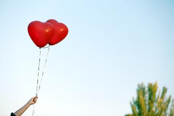 Love heart balloons on sky background