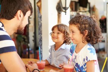 Children Drinking Fruit Smoothies In Restaurant