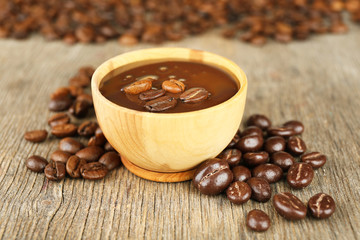 Coffee beans with chocolate glaze on wooden background
