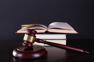 Judge's gavel and books on dark grey background