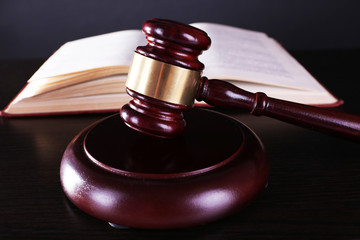 Judge's gavel and open book on table