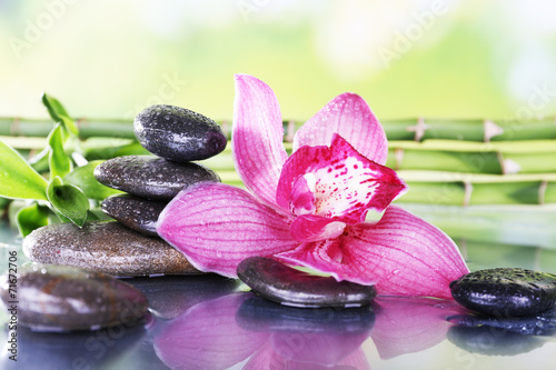 Fotobehang Lilac Spa stones, bamboo branches and lilac orchid