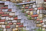 Old White Stone Stairs and multicolored Stonework Wall poster