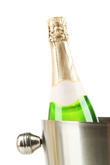 Bottle of champagne in bucket, isolated on white