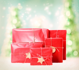 Gift boxes on christmas trees background