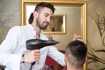 Hairdresser Blow Dry Man's Hair In Shop