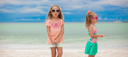 Two little girls during tropical beach