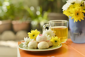 teatime Chinese pastry and tea and flower