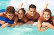 Leinwanddruck Bild - Group Of Teenage Friends Having Fun In Swimming Pool