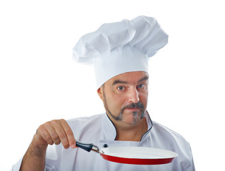 Playful chef holding a frying pan