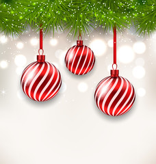 New Year background with glass hanging balls and fir twigs