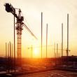 canvas print picture - crane and construction site