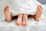 Close up Couple Feet Soles on White Bed