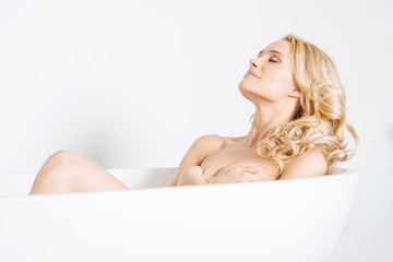 Pretty Young Lady Naked on White Bathtub