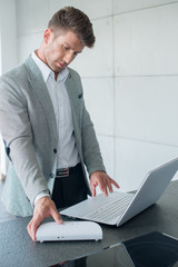 Stylish businessman working on a laptop